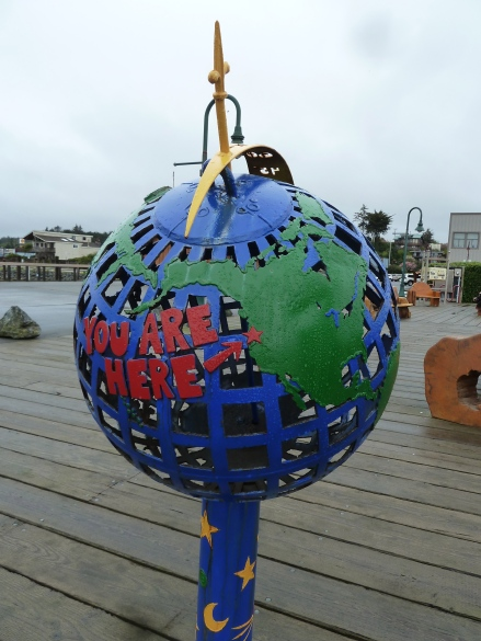 A globe pointing to Bandon displayed at the pier