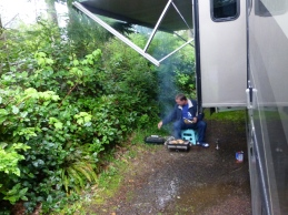 Rain or Shine, the Barbecue Master cooks fine. (This particular day it was raining really hard).
