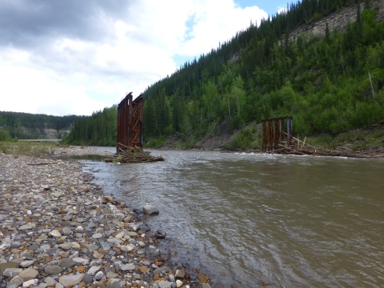 What is left of the wooden Sikanni Chief River Bridge