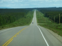 Long and long stretches of straight road approaching Ft Nelson