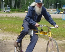 The founder riding on his crooked bike