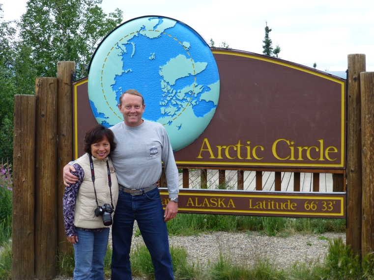 Pose at the Arctic circle sign. We made it!