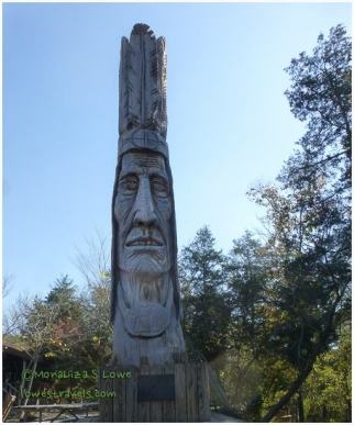 An indian monument carved out of a 450 year-old Bald Cypress