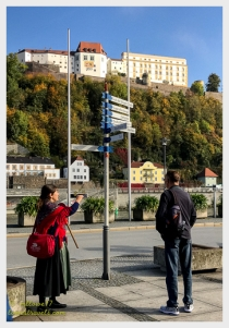 Our guide points at the 13th century Veste Oberhaus fortress that sits atop a hill across the river