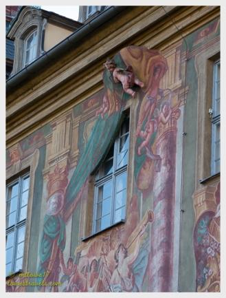 A cherub opening a curtain