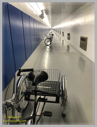 Workers ride bikes from the visitor center to the powerhouse at the center of the dam