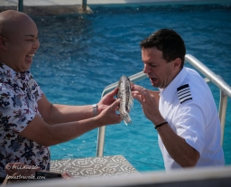 The ship's general manager initiated the ceremony...